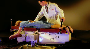 This is a picture of Cox Technic chiropratic spinal manipulation as performed at Pensacola Spinal Rehab Center.
