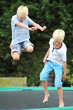 image of kids playing on a trampoline
